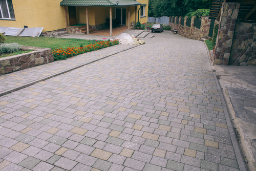 What is better, concrete or pavers?