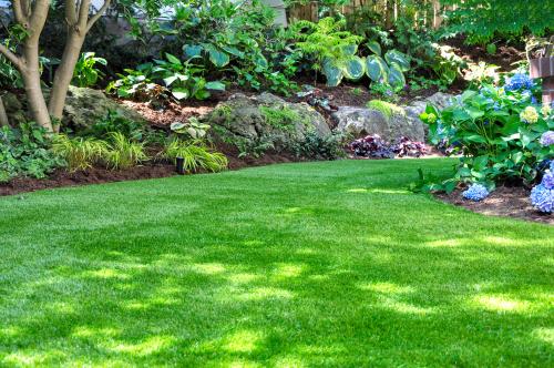 What do you put under artificial grass?